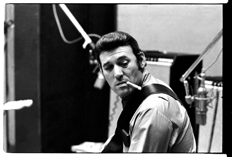 Carl Perkins was the artist who originally wrote, recorded and popularized 'Blue Suede Shoes'.