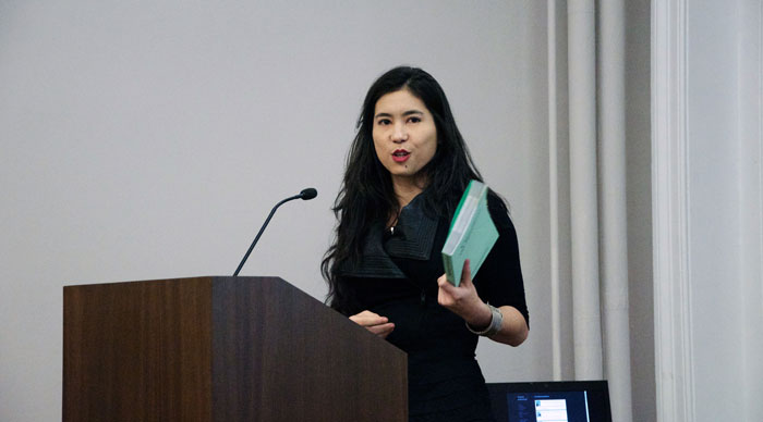 Talking about a printed document containing things others said online. (photo: Cindy Hwang)