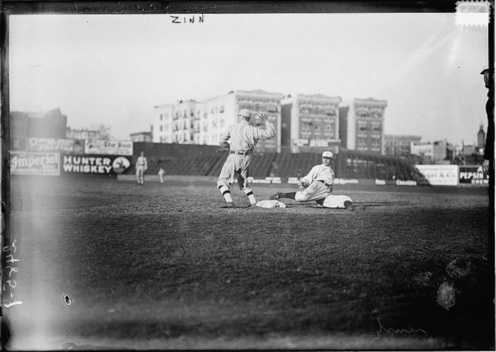 Guy Zinn, New York AL, sliding back into first base against Boston at Hilltop Park, New York City, 1912 (click image for source)