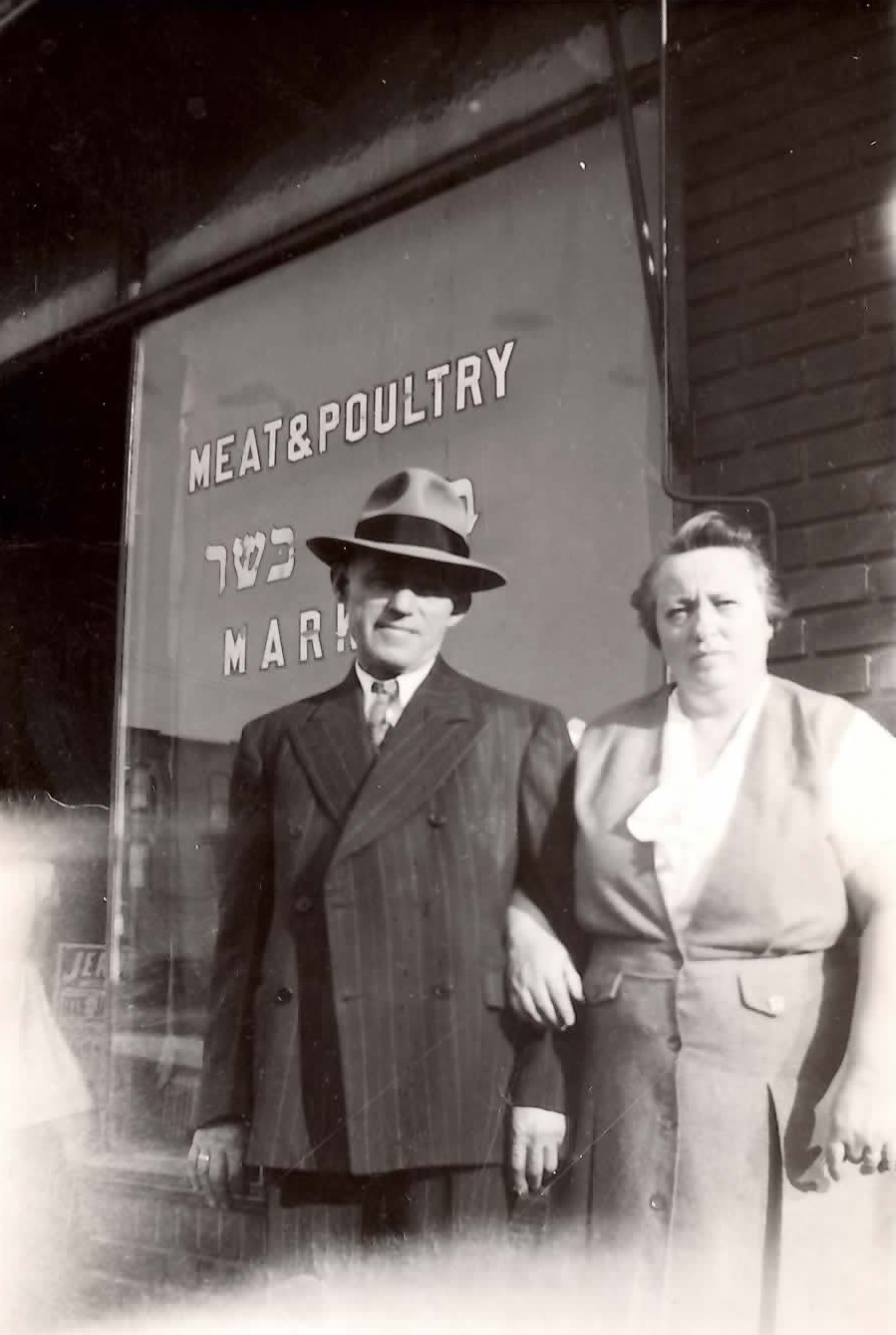 Joseph and Yetta Ring in front of their kosher butcher shop in Queens.