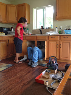 Uncle Ed fixing our sink.