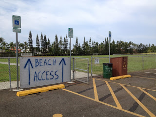This sign, in the middle of the rec center parking lot, led to us a little gem-of-a-beach.