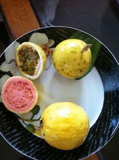 Top fruit: lilikoi; Bottom pink fruit: guava
