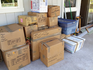 These boxes of (mostly) books are sitting outside, and will likely sit there until we find a permanent home.