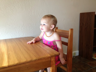 Justice is excited to have her table again - and even more excited that she can sit in her chair and see birds :)
