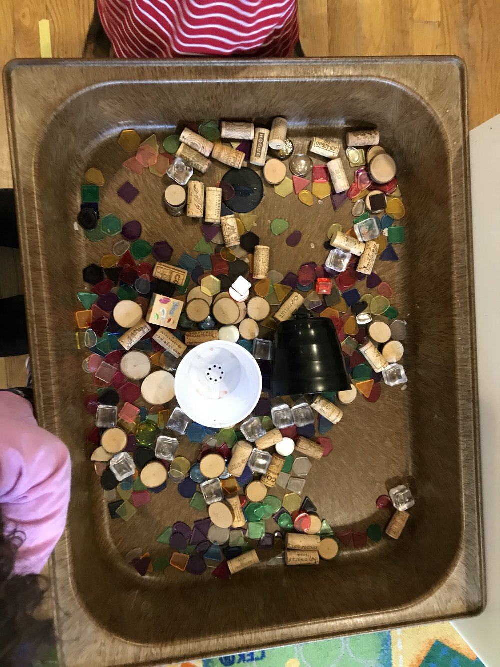 - Today we put beautiful stuff into the sensory table.  The children use beautiful stuff or loose parts in a variety of ways:  sorting, in their dramatic play, filling up bags and trucks.