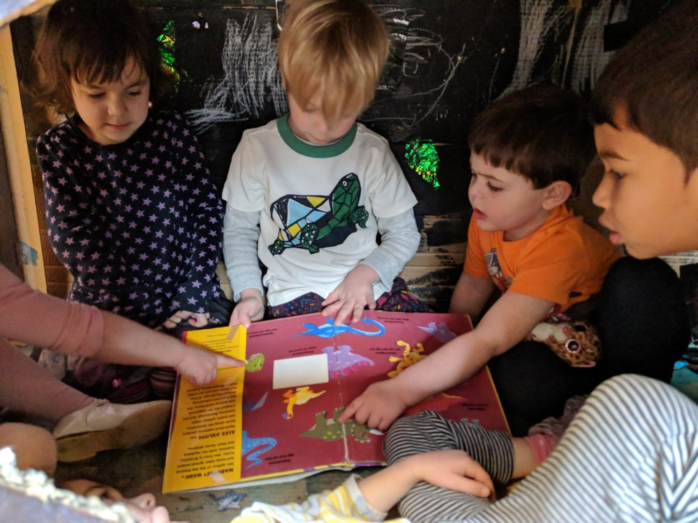 - Preschoolers reading in the cavern-Literacy-Socal Skills