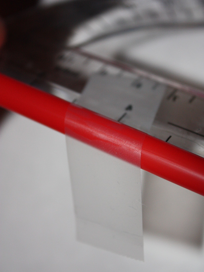 Image 3: Center the protractor beneath the straw.