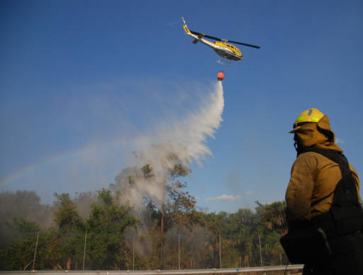 A helicopter helps control a fire in the Florida Panther National Wildlife Refuge (Image credit: U.S. Fish and Wildlife Service, 2009).