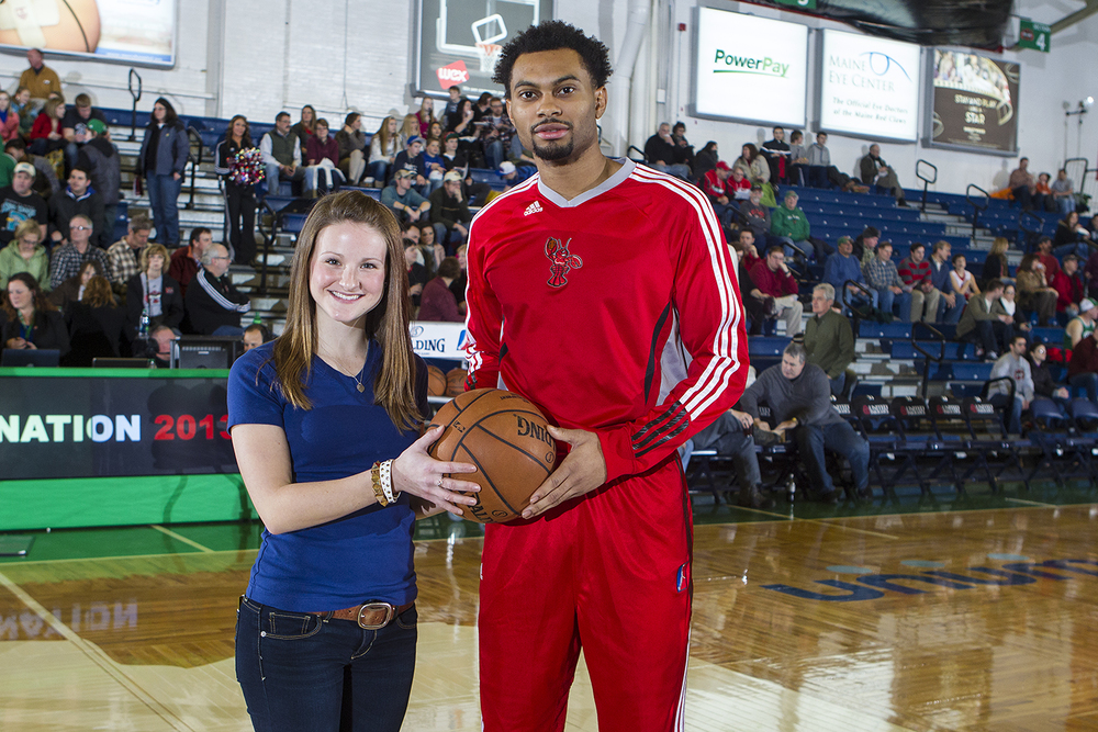 Game Ball Presentation with Maine Red Claws Player Xavier Silas