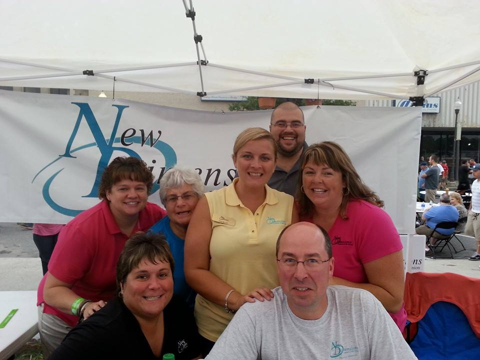 New Dimensions Federal Credit Union Staff at Taste of Waterville Event, fundraising for Maine Children's Cancer Program, 2014.