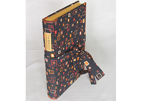 Binder: Karen Hanmer: Collection of Short Stories by various authors, The Bedroom Companion Farrar and Rinehart, New York, NY, 1935. Millimeter binding. A compilation of naughty stories for men, bookcloth made by binder from fabric reminiscent of a hipster's dressing gown. Goatskin trim at foredges, head and tail. The edges are colored with acrylic to match the paper label.