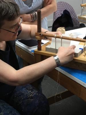 Karen at the sewing frame.