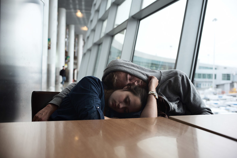 Lovely couple sleeping at Moscow airport, 5am.