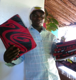 MARTIN with his latest product; laptop bags made out of used kites!