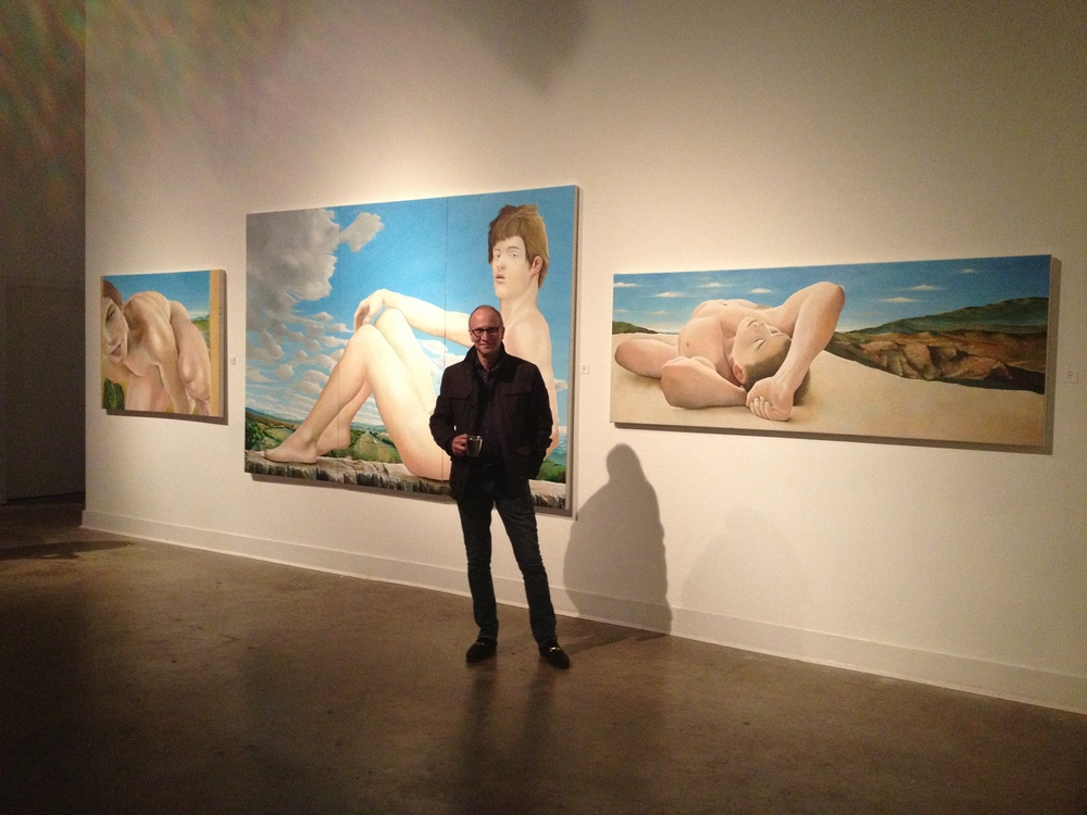 Artist in front of his works at the showing at the Hart Witzen Gallery, Charlotte, NC