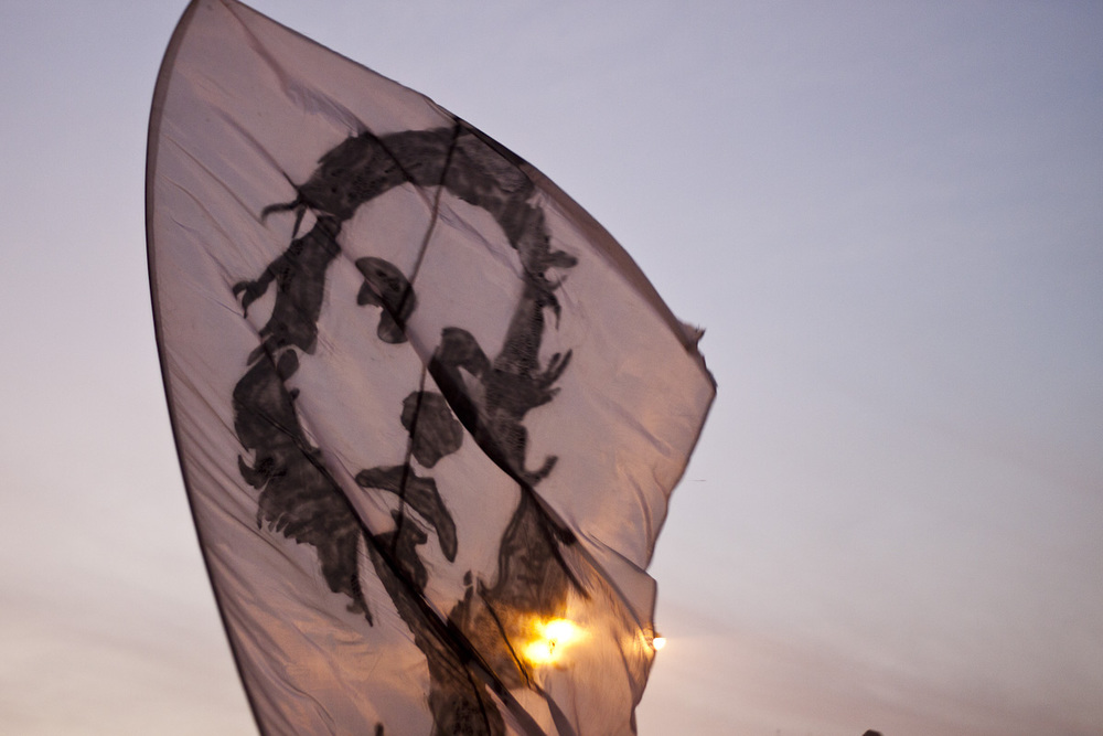 Flag bearing image of Mina Danial flies over Tahrir Square