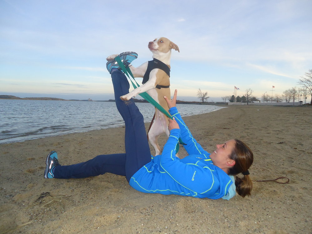 My trainer, Willie helping me through my hamstring stretch. Is there anything better than yoga with dogs?