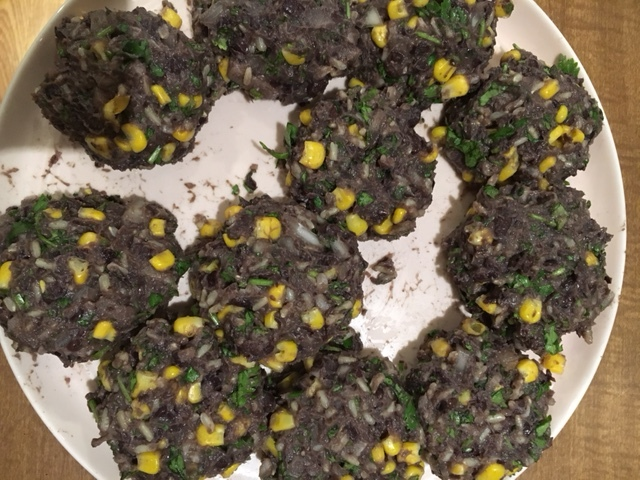 Here is what they look like when freshly formed. Lots and lots of cilantro makes these burgers super delicious and super healthy. The addition of the corn adds some nice texture and sweetness. Let the patties sit in the fridge overnight or at least a few hours so they behave when frying.