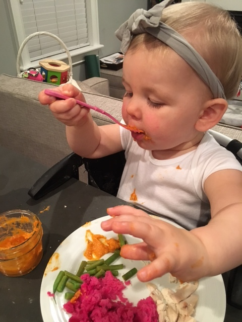 Meet Tommy's friend, Elizabeth, an enthusiastic member of the taste testing club enjoying some delicious hummus with her already healthy meal!
