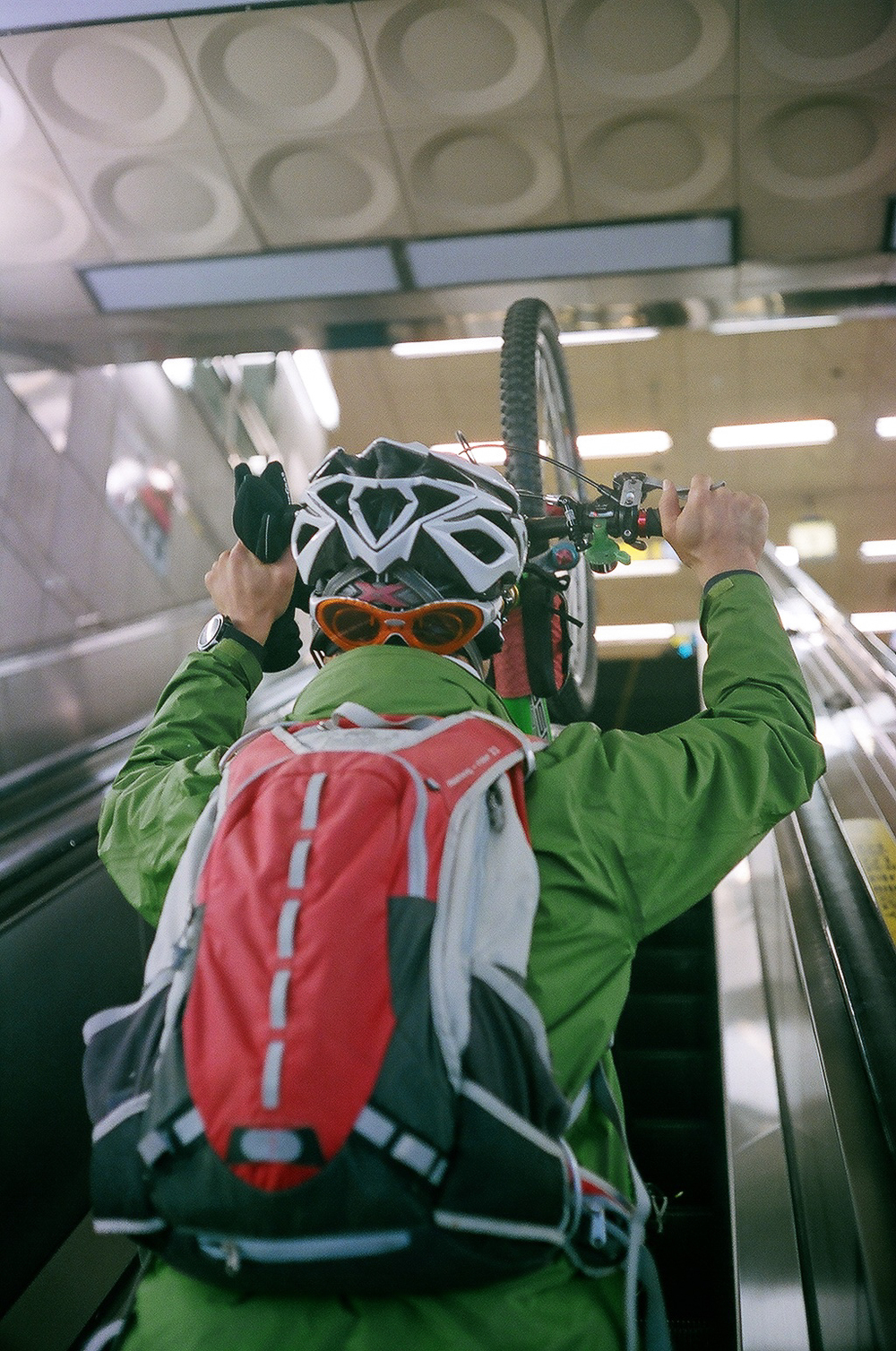 """The Escalator Cyclist"" - It beats taking the stairs I guess.  Seoul, Korea. Canonet QL17, Kodak 200 Colorplus."