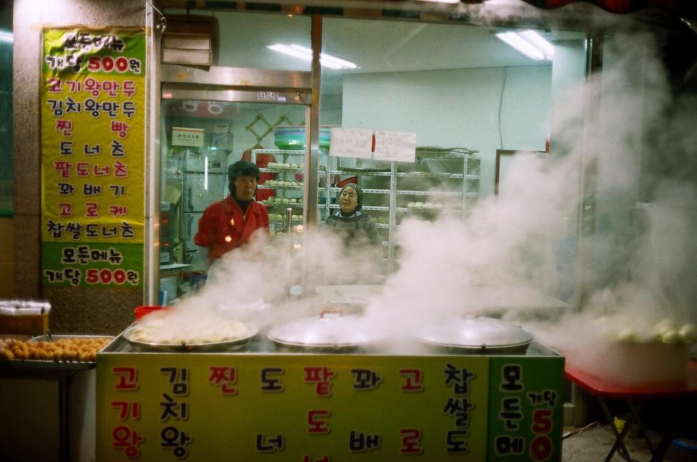 """Cookin' on Steam"" - The steamed buns and Mandu looked amazing.    Seoul, Korea. Canonet QL17, Kodak 200 ColorPlus."