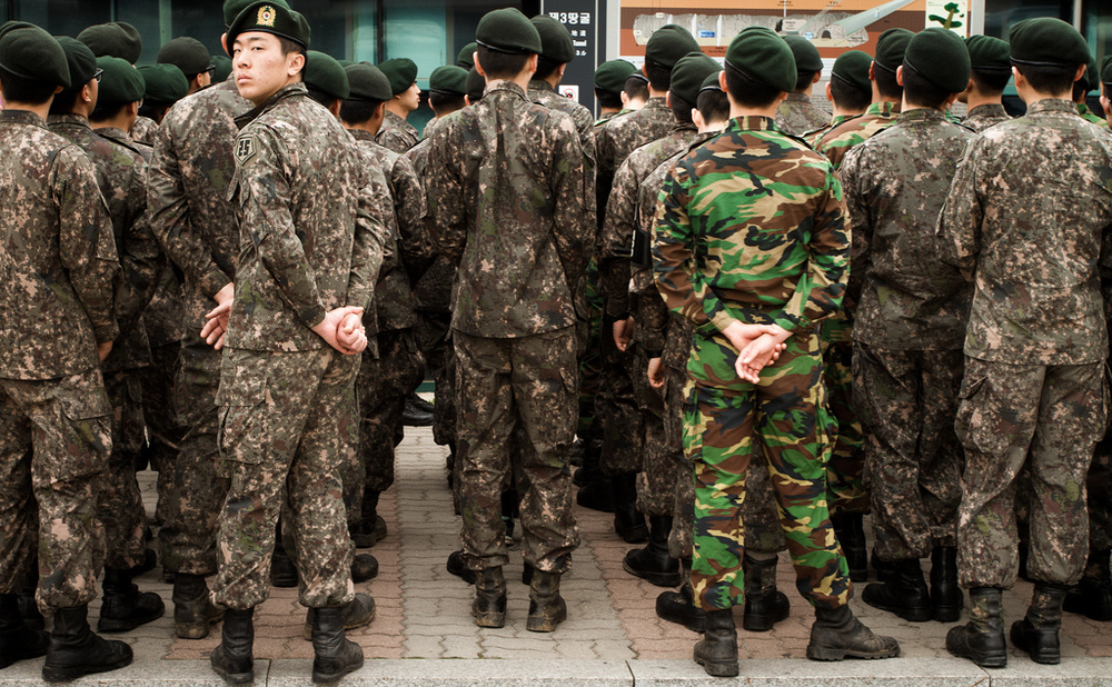 Young Korean men carrying out their mandatory military service.