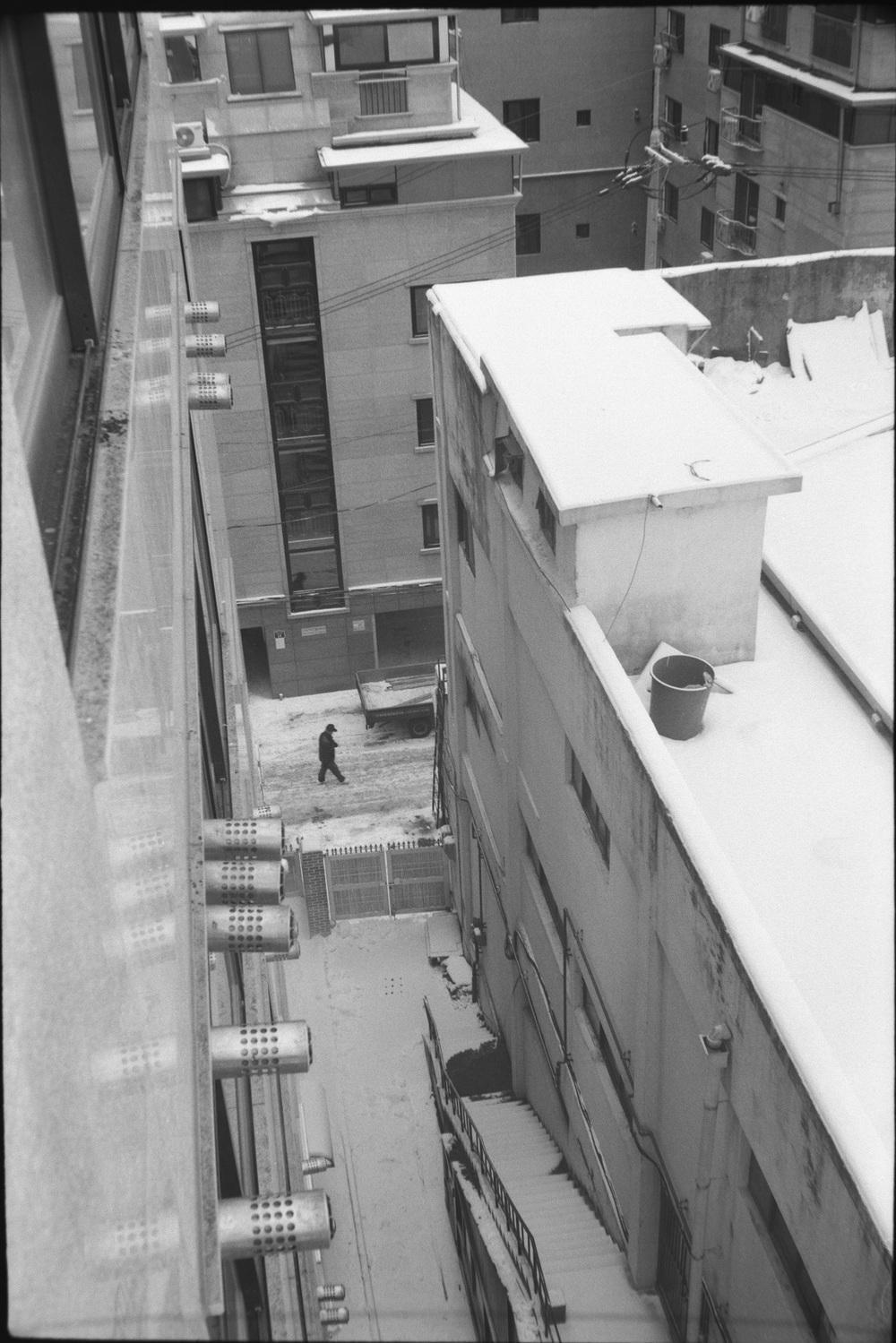 man walking through the snow.jpg