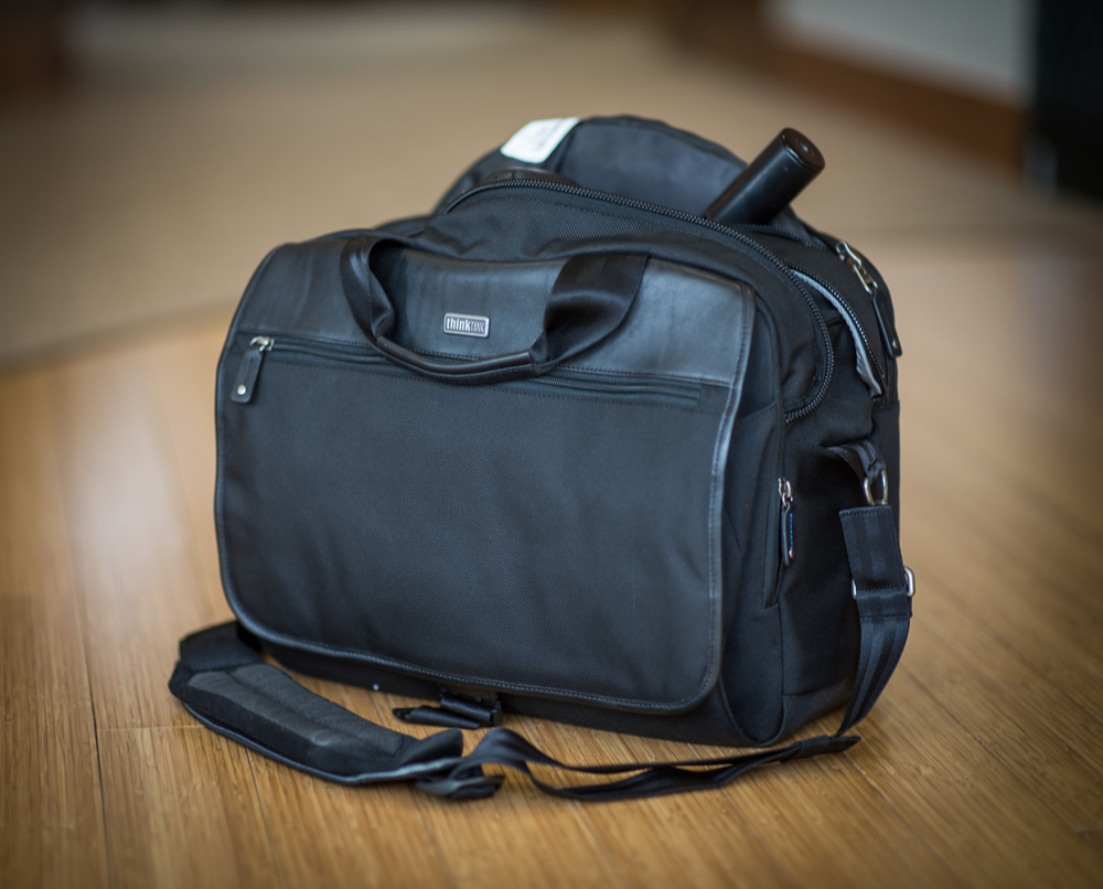 """The laptop pocket on the back side also doubles as my pocket for my 42"""" 5-in-1 pop-up disc and LunaGrip disc holder. All my lighting gear in one bag!"""