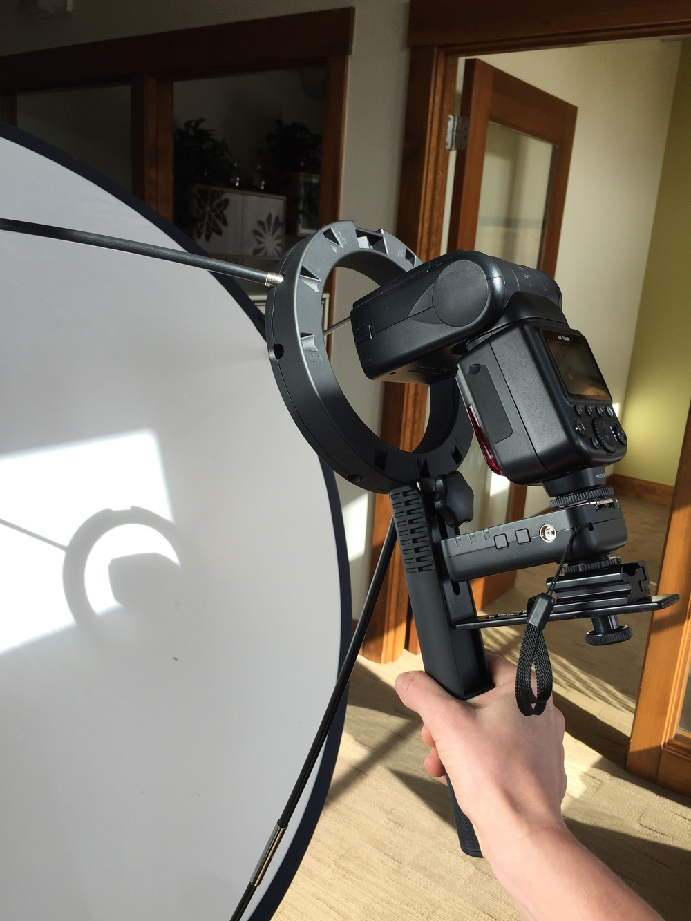 The yongnuo transceiver holds a BOLT flash unit on the Westcott Lunagrip flash diffuser.
