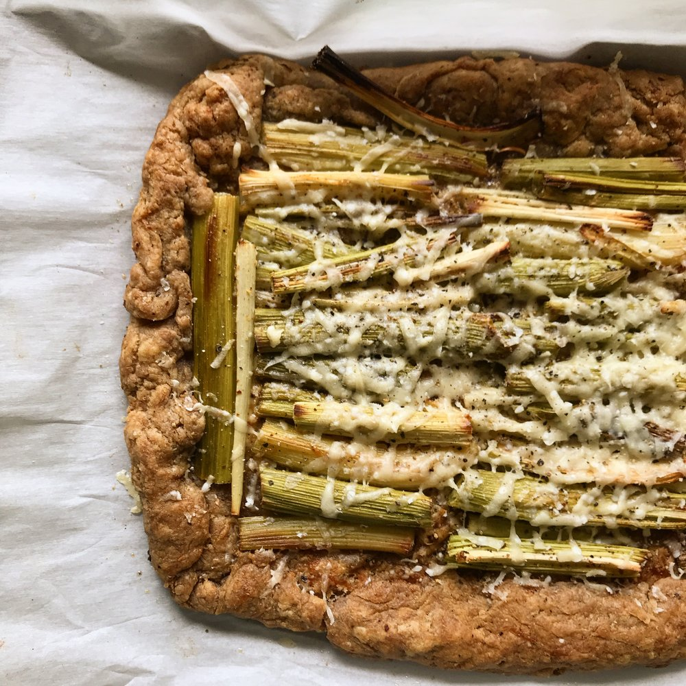 Whole grain galette with roasted green garlic and parmesan. A test made with rye, Red Fife, and Acadia wheat strains.