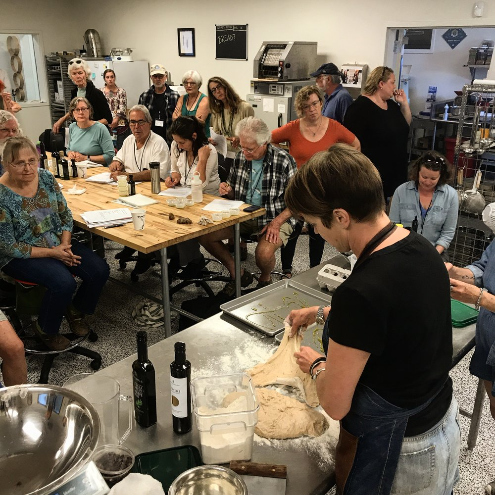 A crew of home and professional bakers learn how to use whole grain flours at the Grain Gathering, held annually at Washington State University's Bread Lab.