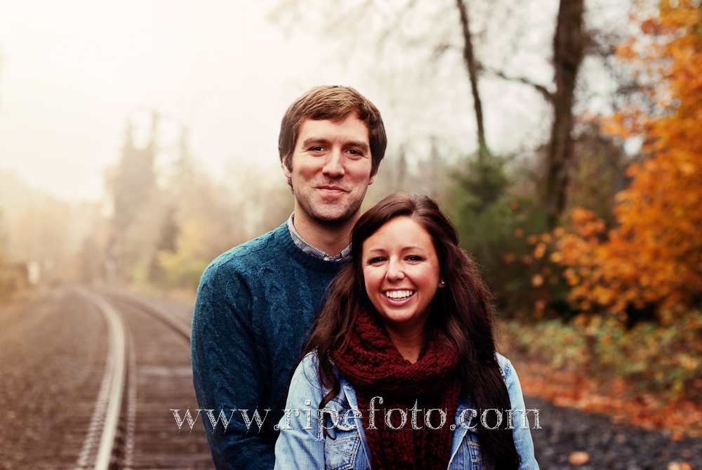 Portrait of couple on train tracks by Ripe Photography.
