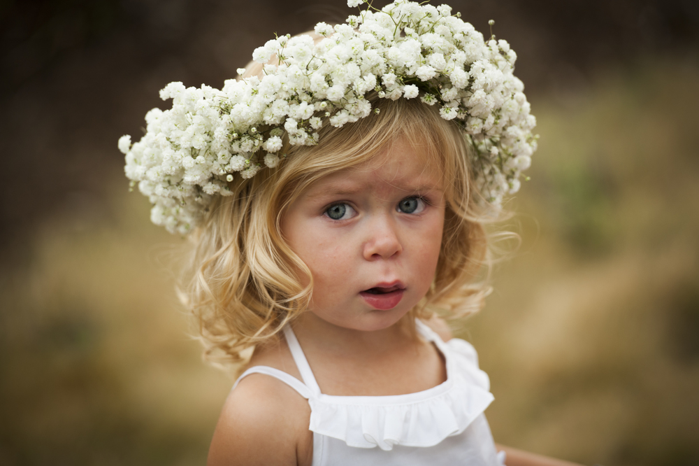 Portrait of flower girl by Ripe Photography.