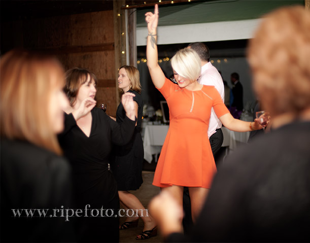 Portrait of woman dancing at wedding by Ripe Photography.