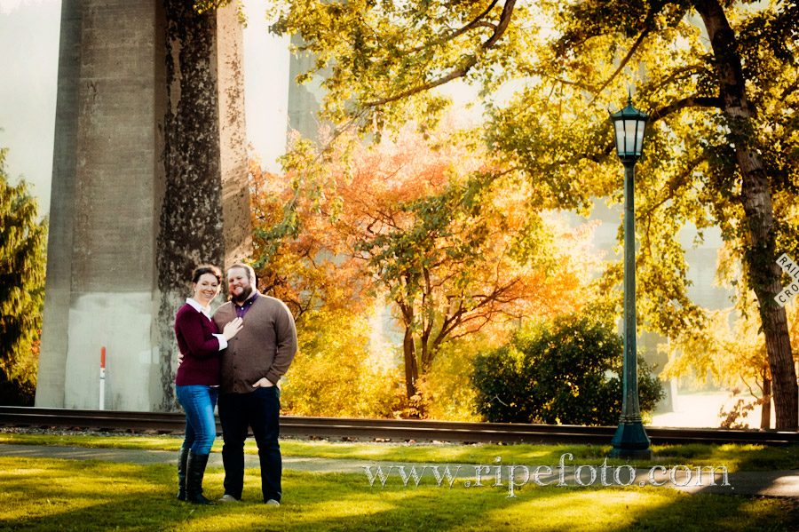 Portrait of couple in Cathedral Park under the St. John's Bridge in Portland, Oregon by Ripe Photography.