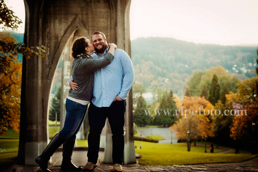 Portrait of couple under the St. John's Bridge in Portland, Oregon by Ripe Photography.