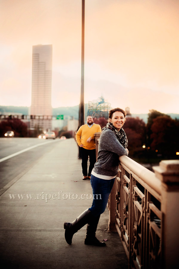 Portrait of couple on the Burnside Bridge at sunset in Portland, Oregon by Ripe Photography.