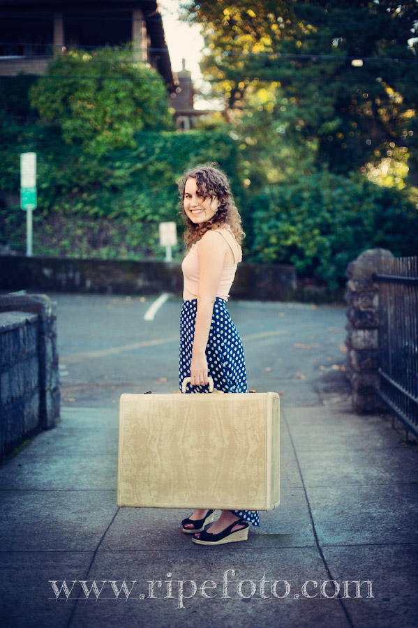 Portrait of teenager with suitcase by Ripe Photography.