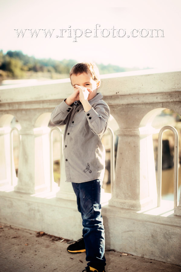 Portrait of young boy doing karate on Oregon City Bridge by Ripe Photography.