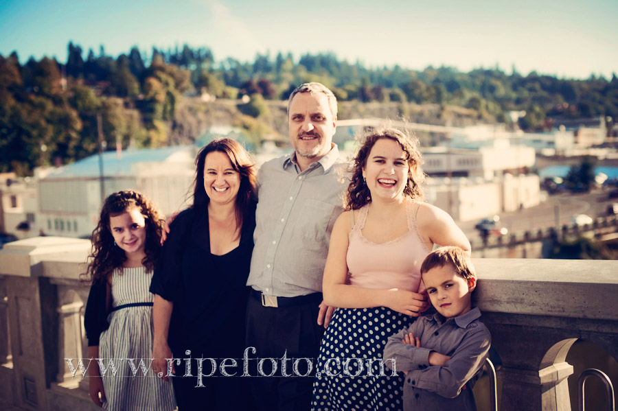 Fall portrait of family on Oregon City Bridge overlooking Willamette Falls by Ripe Photography.