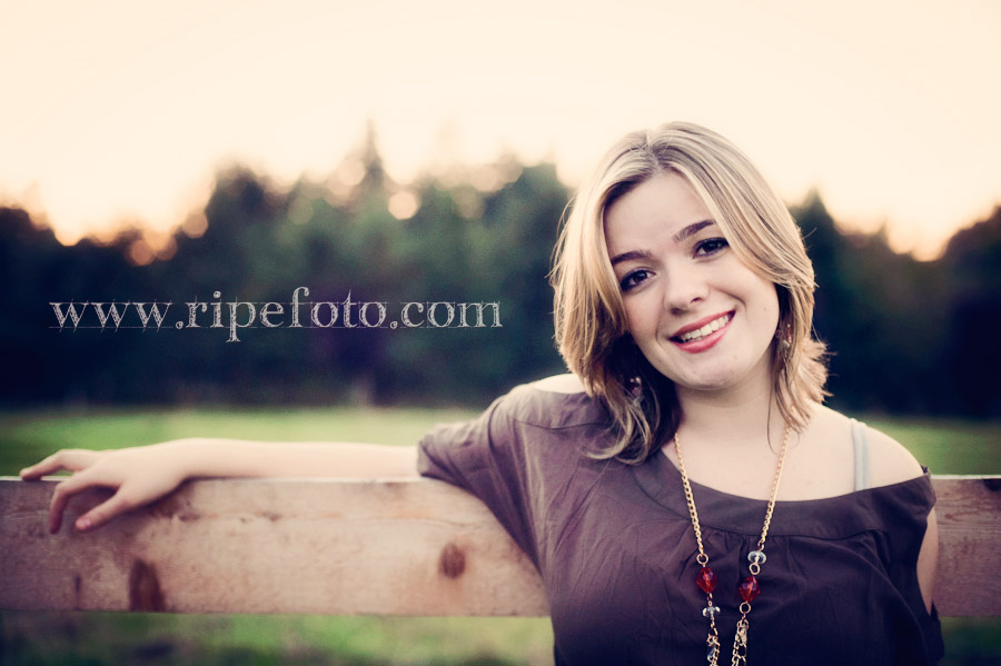 Portrait of teen girl near rustic fence by Ripe Photography.