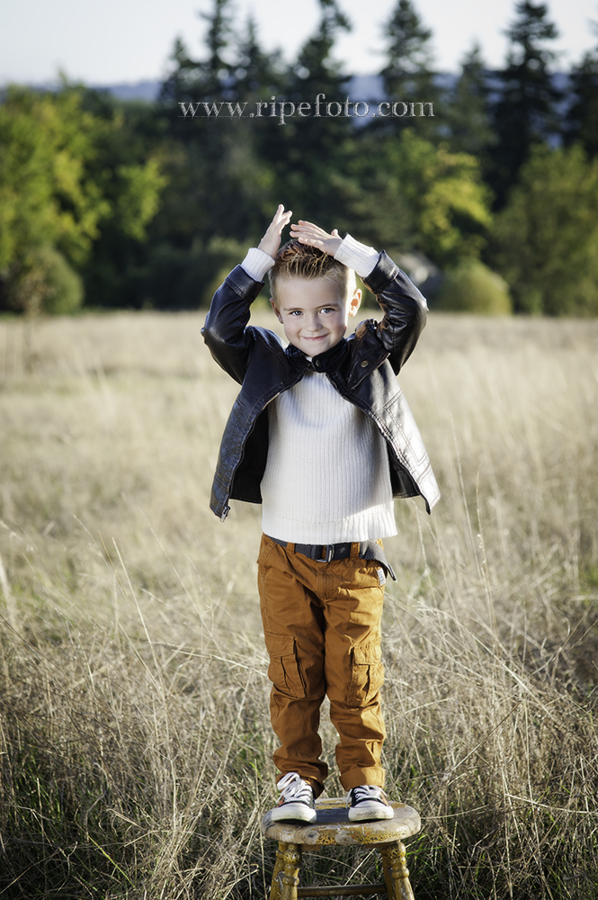 Portrait of kid on stool in field by Portland portrait photographer Ripe Photography.