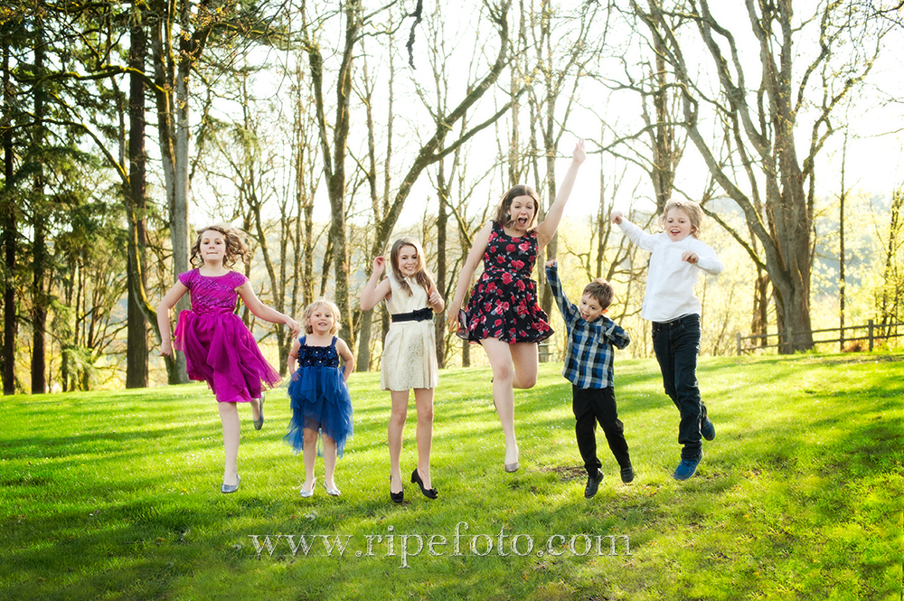 Portrait of children in woods in Portland, Oregon by portrait photographer Ripe Photography.