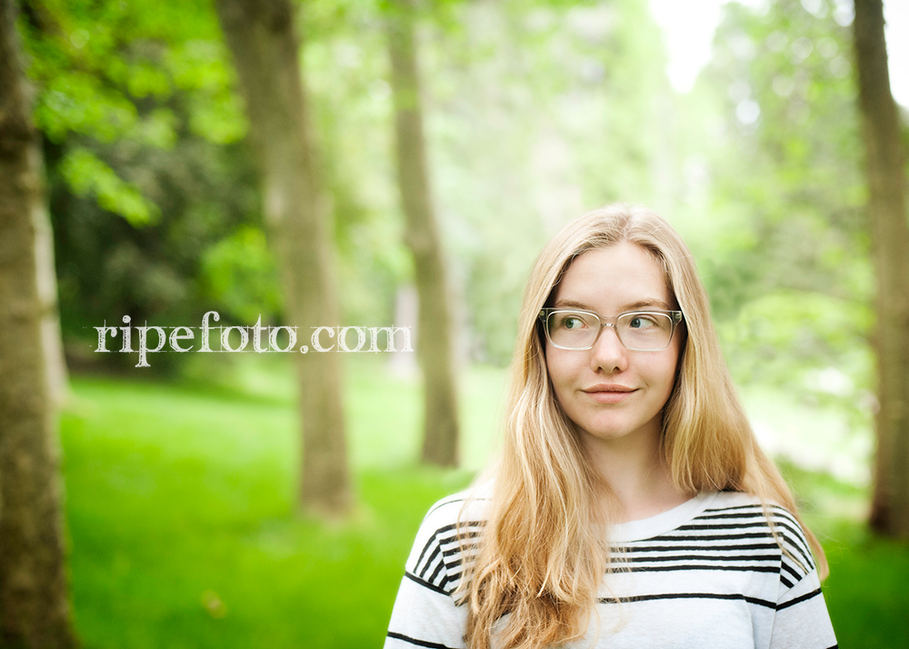 Senior portrait of teen in Lithia Park, Ashland, Oregon by senior portrait photographers at Ripe Photography.