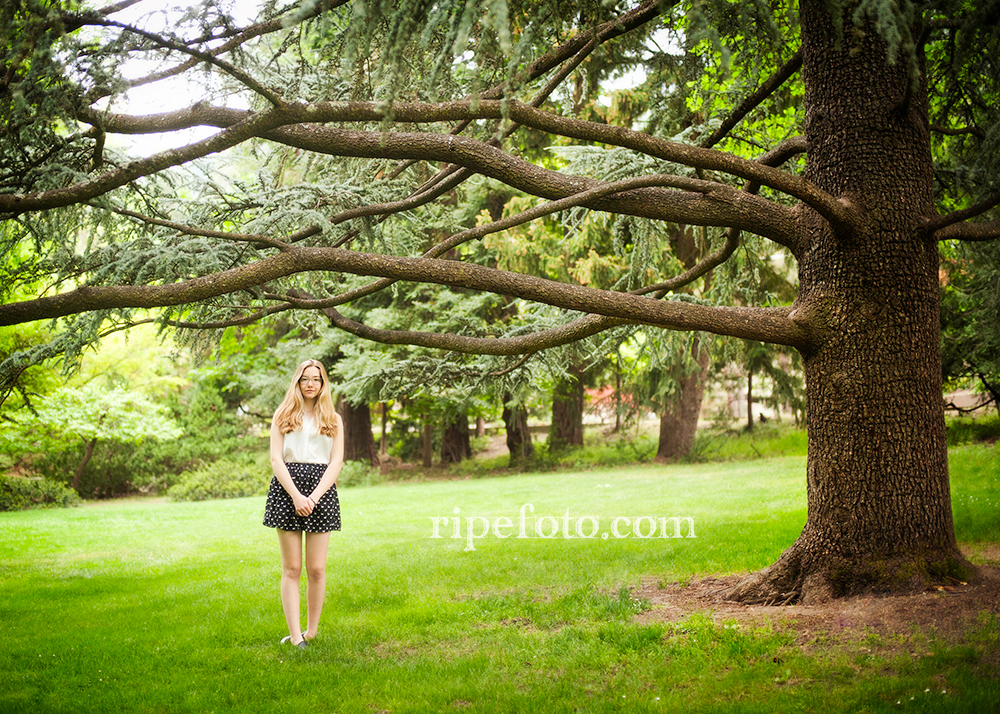 Senior portrait of teen girl in Ashland, Oregon at Lithia Park by senior portrait photographers at Ripe Photography.
