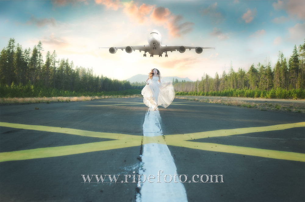 Conceptual portrait of woman and plane in the mountains by Portland, Oregon fine art photographer Ripe Photography.