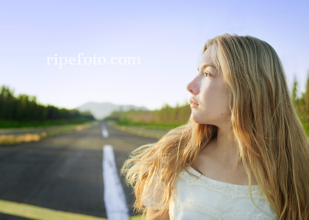 Portrait of woman on mountain runway by Portland, Oregon fine art photographer Ripe Photography.