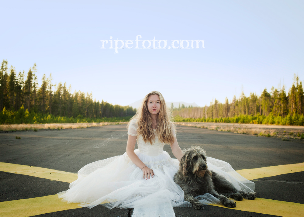 Conceptual portrait of woman and dog on mountain runway by Portland, Oregon fine art photographer Ripe Photography.