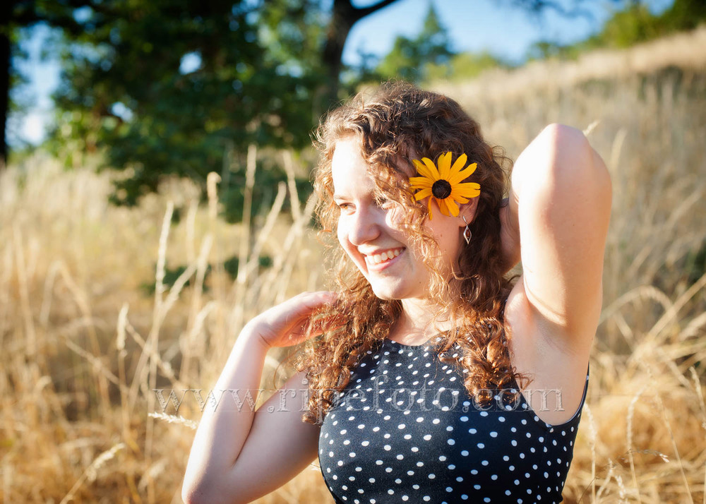 Portrait of teenager in field background by teen photographers at Ripe Photography in Portland, Oregon.